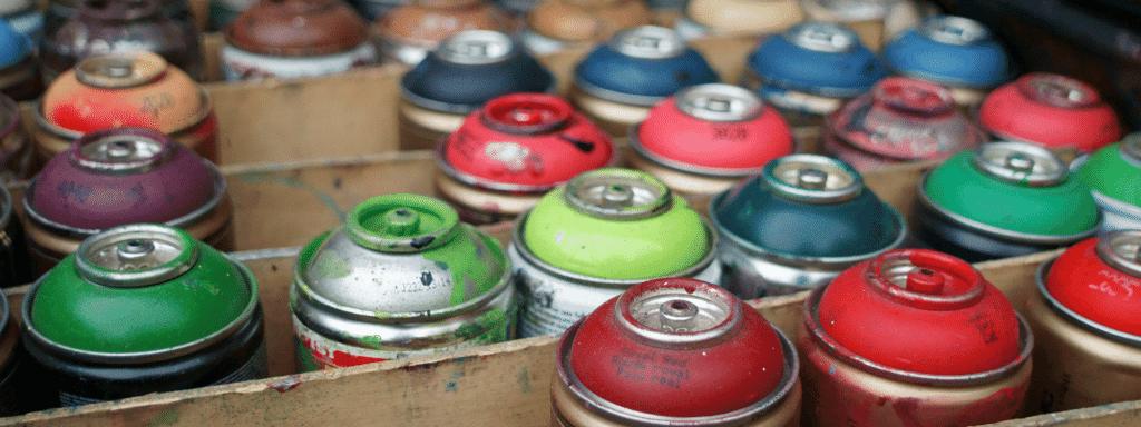 Spray paint cans awaiting disposal